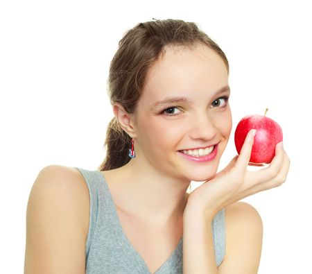 beautiful happy young woman with an apple isolated against white background photo