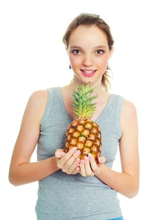portrait of a pretty young brunette woman with a pineapple photo