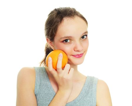 loose skin: beautiful happy young woman with an orange isolated against white background Stock Photo