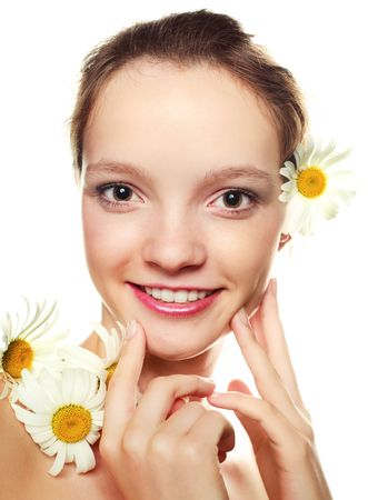 pretty girl with many camomiles against white background photo