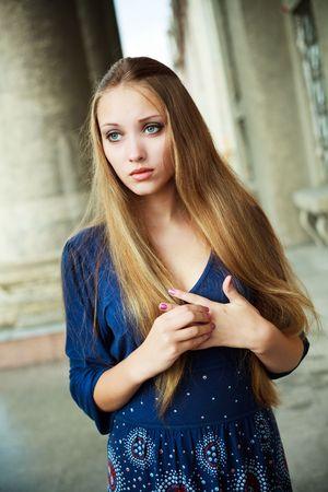 dilemma: portrait of a pretty upset girl outdoor
