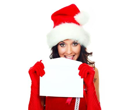 helpers: beautiful young brunette woman dressed as Santa licking an envelope to glue it