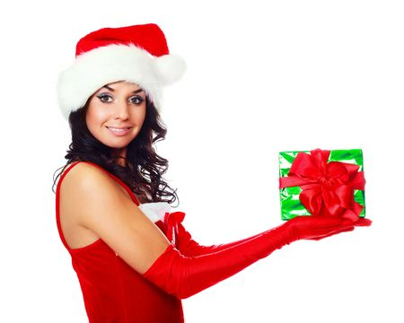 beautiful young brunette woman dressed as Santa with a present in her hands photo