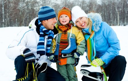 figure skater: happy young parents going ice skating with their son