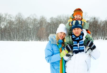 snow break: happy young family spending time outdoor in winter
