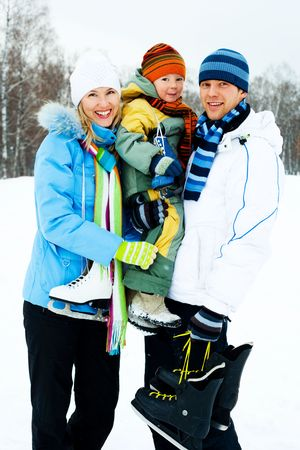 happy young parents going ice skating with their son Stock Photo - 6027553
