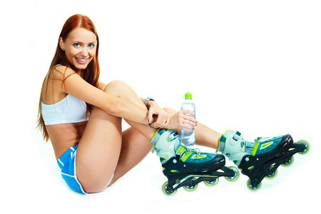 rollerskates: pretty happy girl with rollerskates against white background