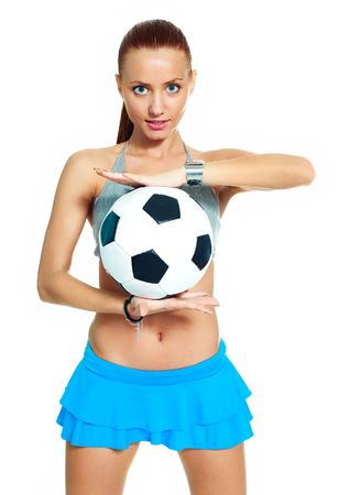 beautiful girl with a football ball against white background photo