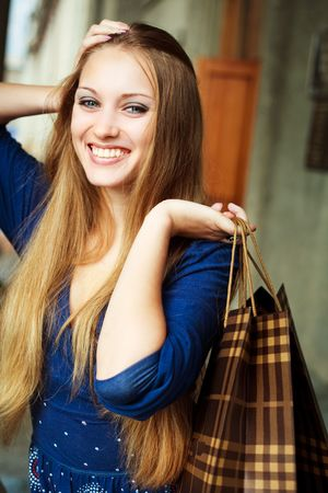 pretty happy young woman with shopping bags outdoor Stock Photo - 6027565