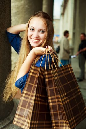 pretty happy young woman with shopping bags outdoor Stock Photo - 6027528