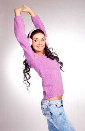 earmuff: pretty young brunette woman wearing pink earmuff
