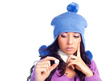 hesitating: hermosa chica hesitating sosteniendo una tableta en su mano aislado sobre fondo blanco  Foto de archivo