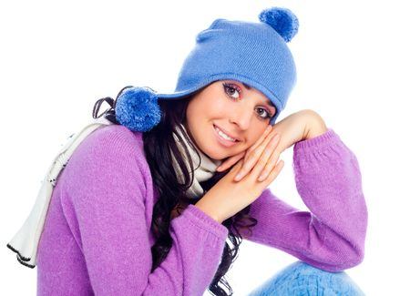 pretty young brunette woman wearing a blue hat photo