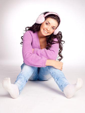 earmuff: dreamy young brunette woman wearing pink earmuff