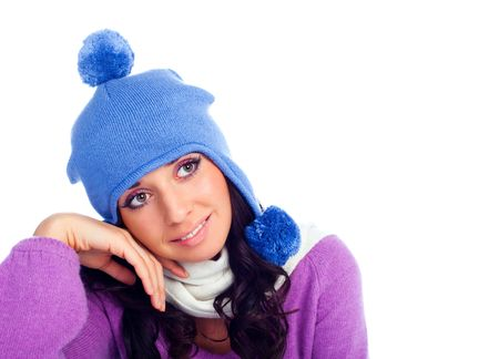 pretty young dreamy brunette woman wearing a blue hat photo