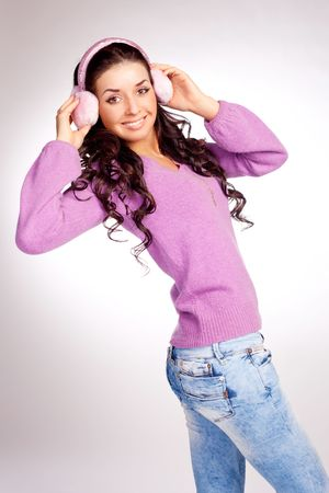muff: pretty young brunette woman wearing pink earmuff