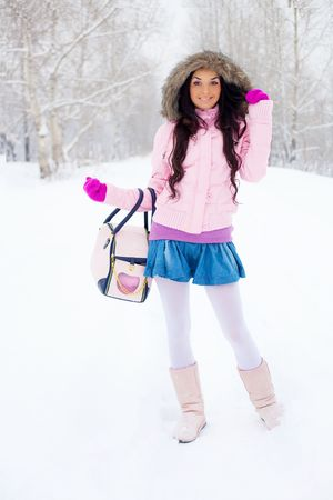 pretty brunette girl having a walk outdoor in wintertime photo