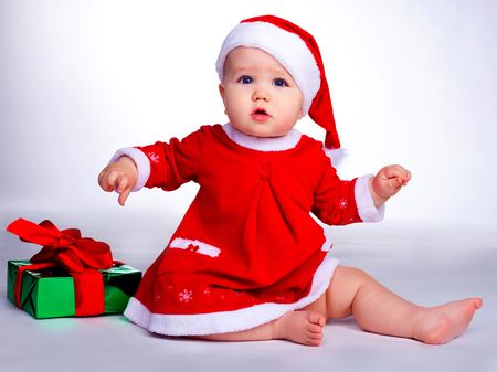 little baby dressed as Santa sitting on the floor with Christmas presents Stock Photo - 6185926