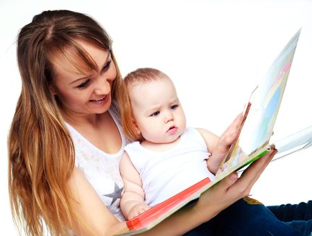 attracive: young attractive mother reading a book to her daughter
