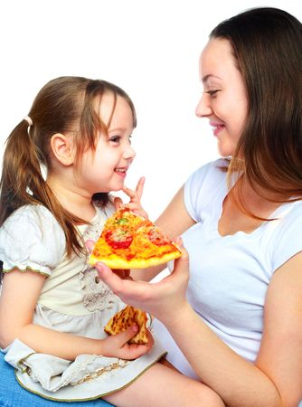 young mother and her little daughter eating pizza and having fun photo