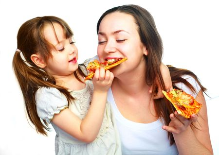 woman eat: young mother and her little daughter eating pizza and having fun