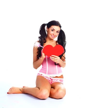 pretty brunette girl writing something on a Valentine card Stock Photo - 6207786