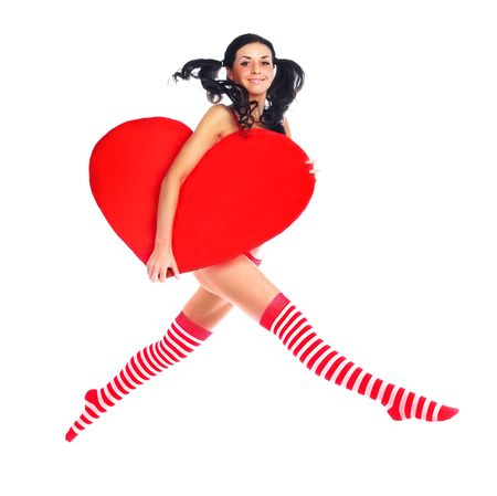pin stripe: sexy young jumping woman with a big heart in her hands