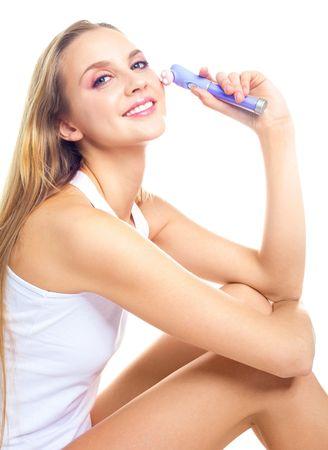 portrait of a beautiful woman making herself a face massage photo