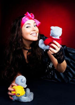 pretty young brunette woman on the floor with toys photo