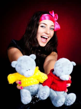 pretty young brunette woman giving us toys photo