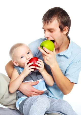 happy young father and his little son eating apples photo