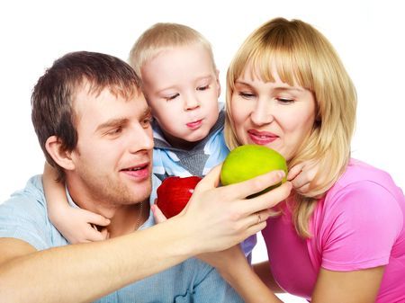 happy young family eating apples, embracing and laughing photo