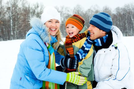 happy young family spending time outdoor in winter photo