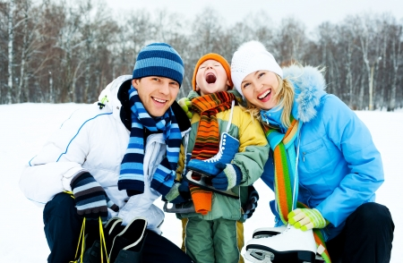 happy young parents going ice skating with their son photo