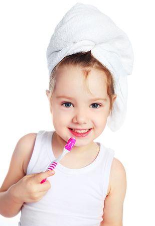 brush teeth: cute little girl with a towel on her head brushing her teeth