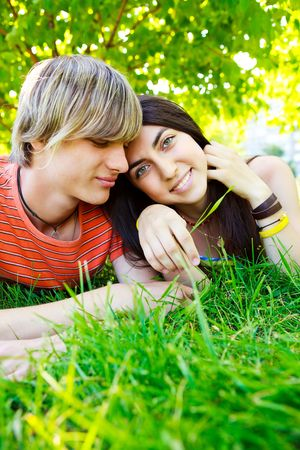 happy young couple spending time in the park in summer photo