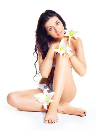 portrait of a beautiful young brunette woman with lilies Stock Photo - 6403083