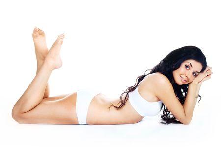 wit ondergoed: prachtige jonge brunette vrouw dragen van witte ondergoed