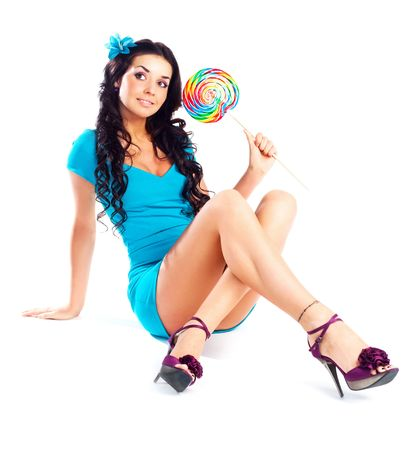 pretty smiling brunette girl with a lollipop in her hand photo
