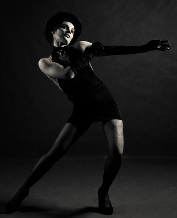 jazz dancer wearing a black cylinder hat, a butterfly bow tie and gloves photo