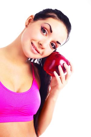 beautiful young brunette girl eating a big red apple photo