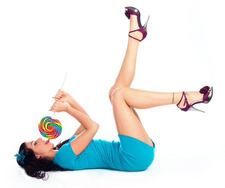 beautiful young brunette woman with a lollipop in her hand photo