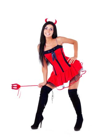 sexy brunette girl wearing a halloween costume of an imp Stock Photo
