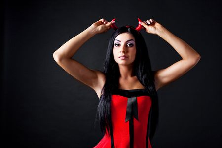 imp: sexy brunette girl wearing a halloween costume of an imp Stock Photo