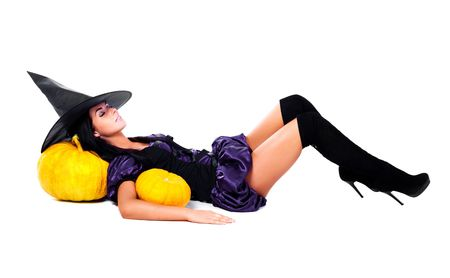sexy boots: pretty sleeping young brunette woman dressed as a fairy with  pumpkins