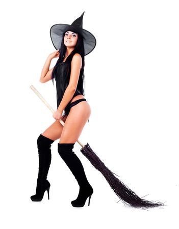 pretty sexy young brunette witch with a broom photo