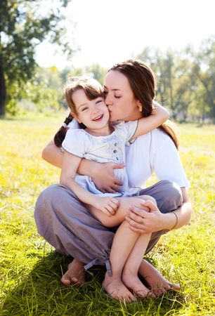daughter: beautiful young mother and her daughter in the park on a sunny autumn day Stock Photo