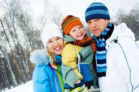 happy young parents going ice skating with their son Stock Photo - 7789049