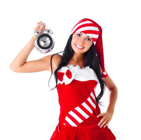 beautiful young brunette woman dressed as Santa with an alarm clock Stock Photo - 7789074