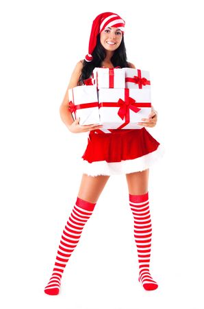 beautiful young brunette woman dressed as Santa with presents in her hands photo